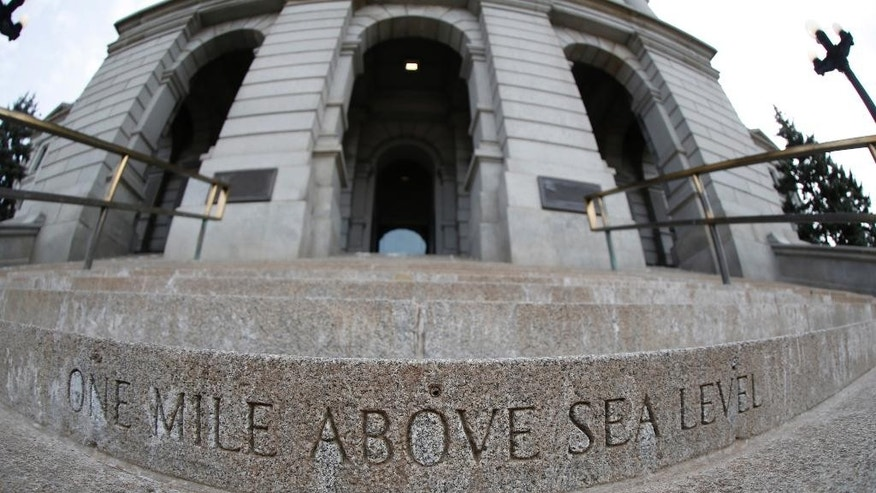 "A marker carved in one of the west steps of the State Capitol denotes the ""one mile above sea level"" elevation in Denver on Friday, March 13, 2015. In an article published in March 2015, geologists from the University of Colorado suggest chemical reactions triggered by water far below the Earth's surface could have made part of the continental plate less dense. Because the plate floats on the Earth's mantle, the lighter portion might have risen like an empty boat next to one with a heavy cargo _ lifting the vast High Plains far above sea level. (AP Photo/David Zalubowski)"