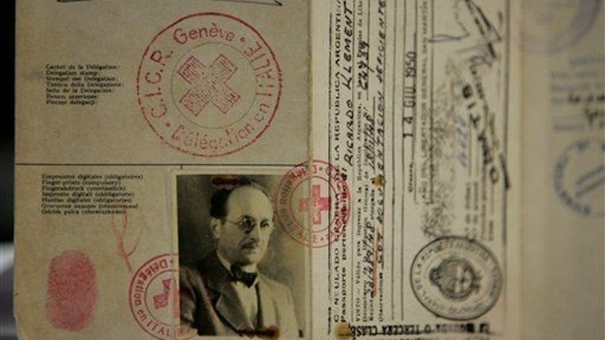 The aging cardboard passport used by Adolf Eichmann, a high-ranking Nazi who escaped to Argentina after World War II, is shown in Buenos Aires.