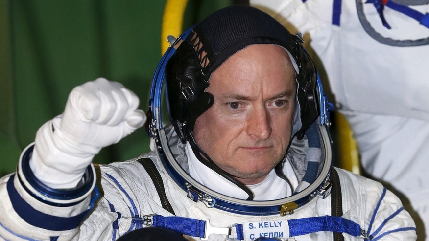 U.S. astronaut Scott Kelly, crew member of the mission to the International Space Station (ISS), gestures before the launch of Soyuz-FG rocket at the Russian leased Baikonur cosmodrome in Kazakhstan.