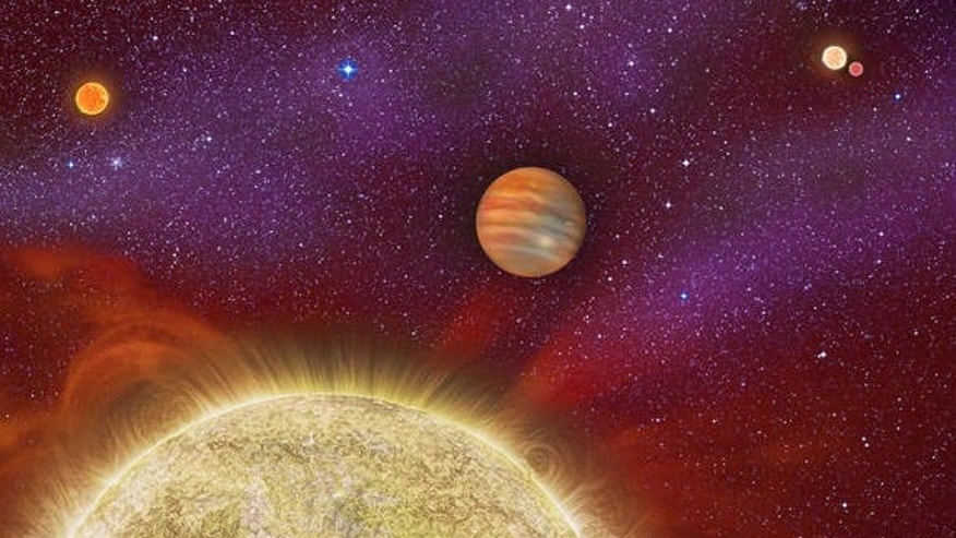 An artist's concept of the four-star system shows a gas giant orbiting its primary star (yellow), while the newfound red dwarf star (upper left) circles nearby. In the distance lie another pair of stars (upper right).