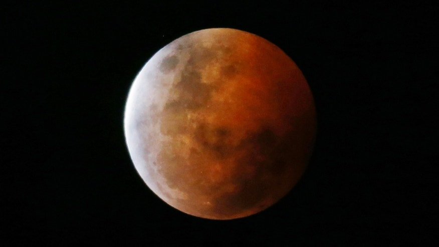 "A total lunar eclipse, also known as a ""blood moon"", is pictured from Gosford, north of Sydney, Oct. 8, 2014."