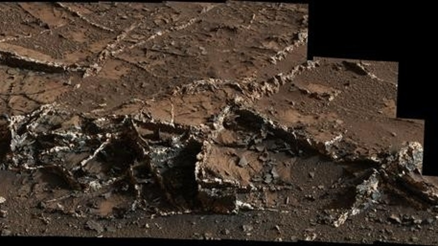 """This photo, taken by NASA's Mars rover Curiosity on March 18, 2015, shows a network of two-tone mineral veins at an area called """"Garden City"""" in the foothills of Mount Sharp."""
