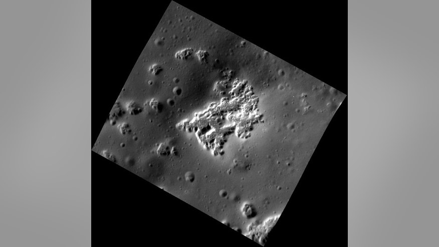 This high-resolution view of Mercury shows hollows — the irregularly shaped, flat-floored depressions — on the southwestern peak ring of the Scarlatti basin. Although there are a number of small impact craters surrounding the hollows, there are