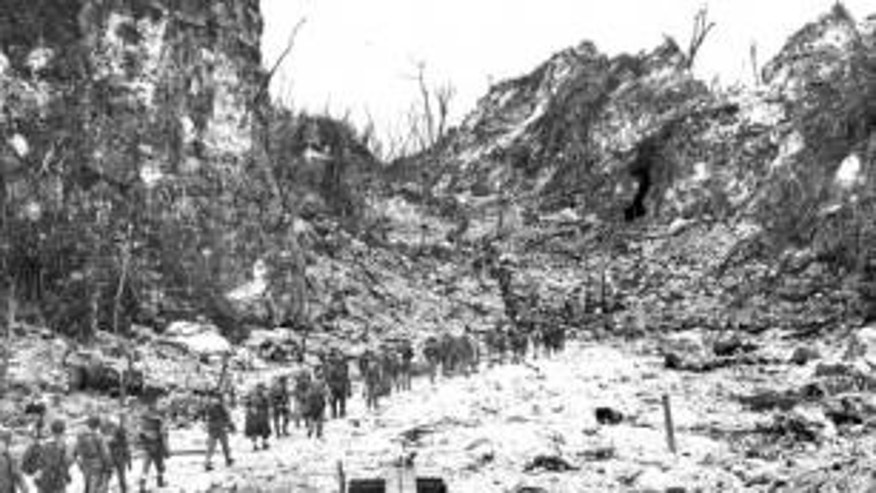 A column of U.S. Marines moves up to the front lines on Peleliu.