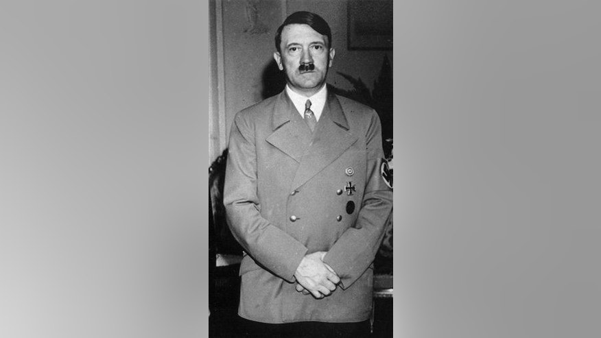 In this Sept. 22, 1938 file photo German dictator Adolf Hitler stands in a room of  the hotel Dreesen, in Bad Godesberg, near Bonn.