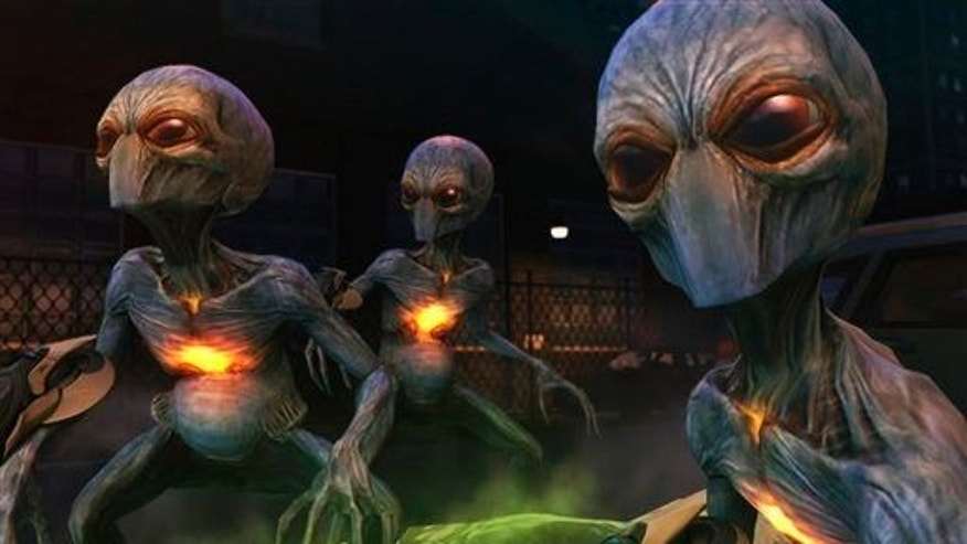 "This video game publicity image released by 2K Games shows extraterrestrial invaders in ""XCOM: Enemy Unknown."""