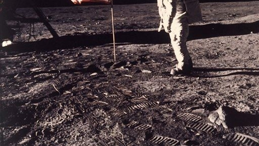 Buzz Aldrin Jr. posing for a photograph beside the US flag deployed on the moon during the Apollo 11 mission in 1969.