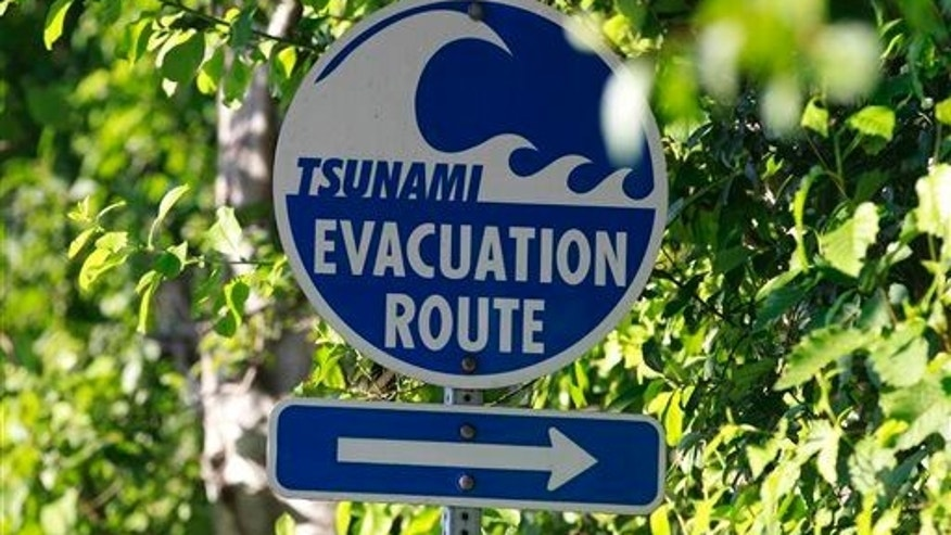 A tsunami evacuation sign in Long Beach, Wash. A new study shows that nearly 5,600 more people could survive a major tsunami hitting the Northwest Coast if they just walk a little faster.