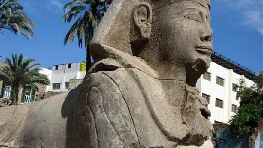 This photo released by the Egyptian Supreme Council of Antiquities in 2010 shows an unearthed sphinx statue of Pharaoh Nectanebo I.