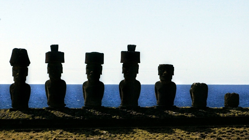 "A view of ""Moai"" statues in the Anakena beach on Easter Island, 2,486 miles west of Santiago, in this photo taken October 29, 2003."
