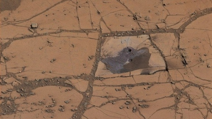The first holes drilled by NASA's Mars rover Curiosity revealed significant amounts of hematite, an iron-oxide mineral.