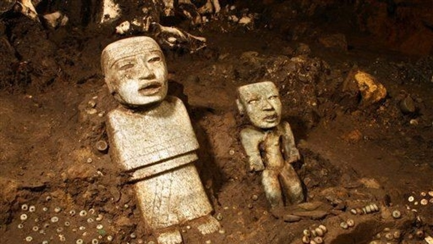 This Nov. 19, 2013 photo, released by Mexico's National Institute of Anthropology and History (INAH), shows sculptures unearthed by investigators at the Teotihuacan archeological site in Mexico.