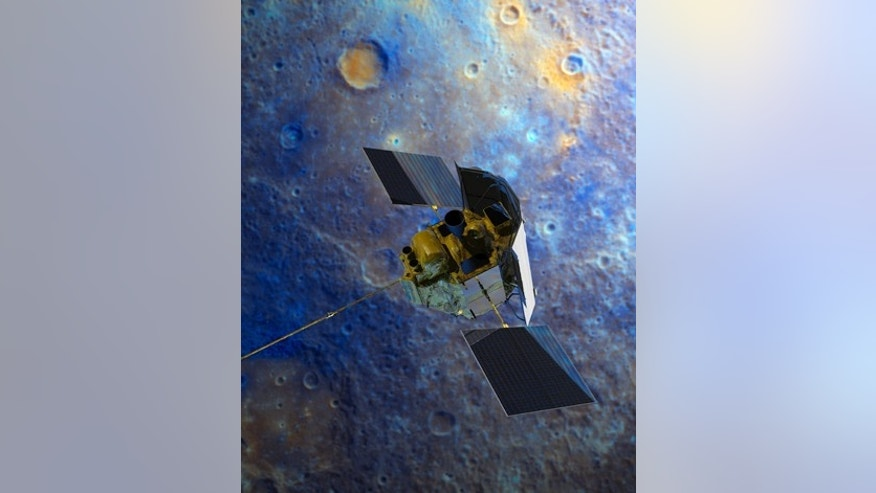 An artist's impression of the Messenger spacecraft is shown flying over Mercury's surface displayed in enhanced color.