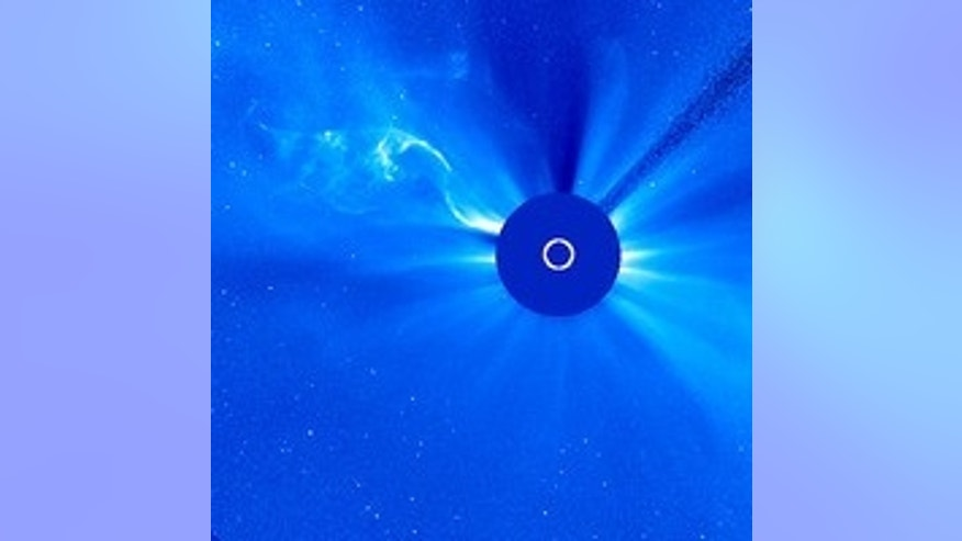 The white circle in the center of the round disk represents the size of the Sun, which is being blocked by occulting disks on SOHO's Large Angle and Spectrometric Coronagraph (LASCO) 3 telescope.