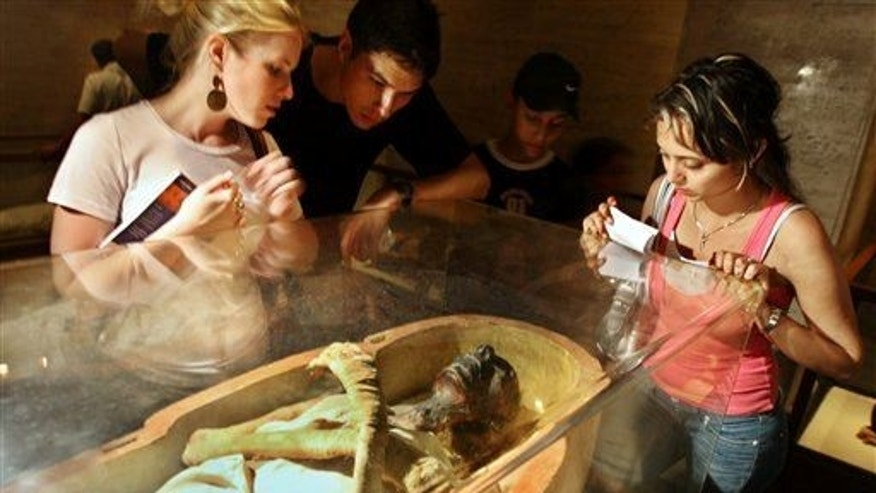 American tourists look at the mummy of Pharaoh King Ramses II, who ruled Egypt for about 66 years (1279-1213 BC).