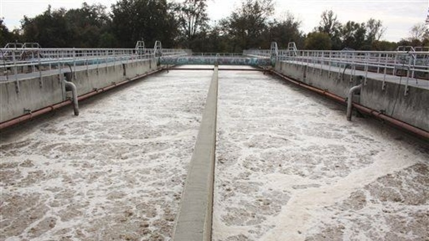 A file photo shows large troughs that aerate the sewage allowing bacteria to grow as it consumes waste from water at a wastewater treatment facility.