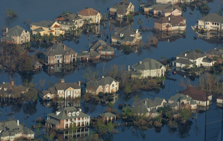 Neighborhoods are flooded with oil and water two weeks after Hurricane Katrina went though New Orleans, Sept. 12, 2005.