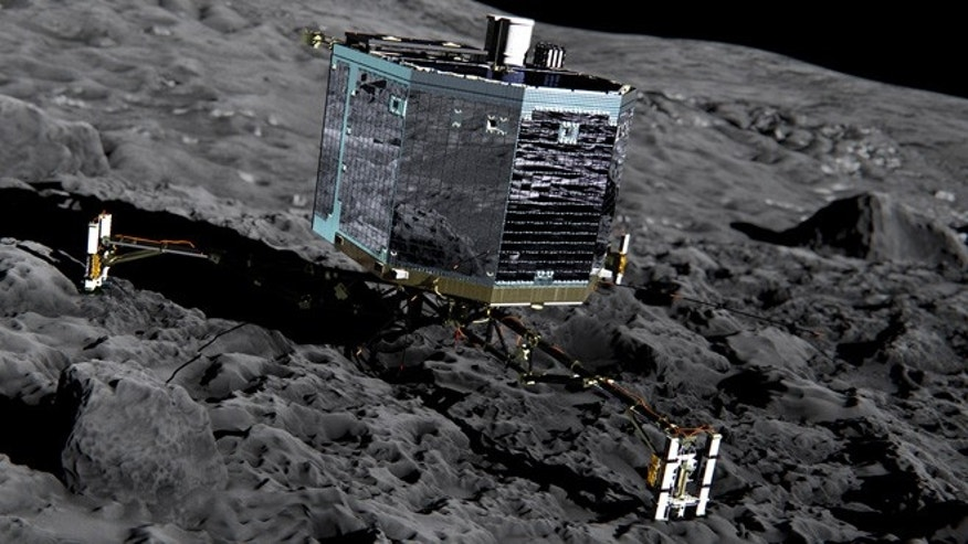 This artist impression  from  Dec. 2013  by ESA /ATG medialab ,  publicly provided by the European Space Agency,  ESA, shows Rosettas lander Philae (front view) on the surface of comet 67P/Churyumov-Gerasimenko.