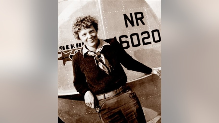 This May 20, 1937 photo, provided by The Paragon Agency, shows aviator Amelia Earhart at the tail of her Electra plane, taken at Burbank Airport in Burbank, Calif. (Albert Bresnik/The Paragon Agency via AP)