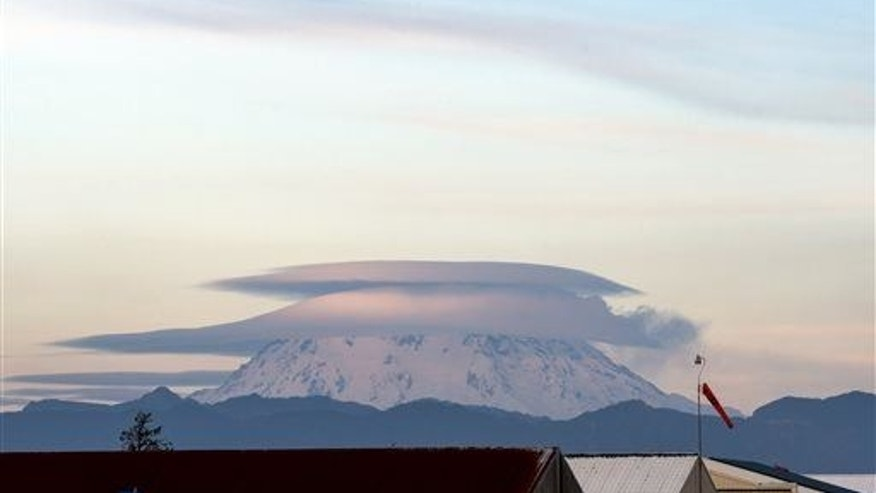 This is obviously not Texas, but this shows what a lenticular cloud (over Mount Rainier) looks like.