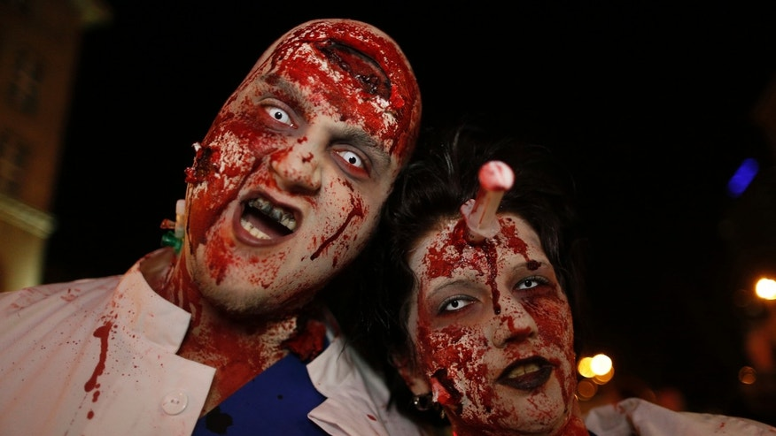 File photo- Revellers take part in a Zombie Walk in Essen October 31, 2014.