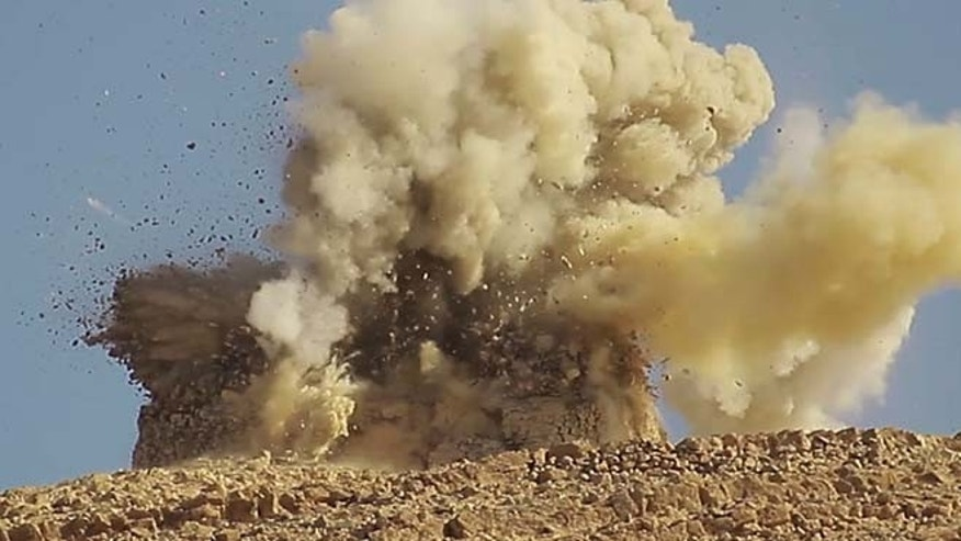 This undated photo released on June 22, 2015, by a militant website, which has been verified and is consistent with other AP reporting, shows one of two mausoleums blowing up by the Islamic State militants, in the historic central town of Palmyra, Syria.