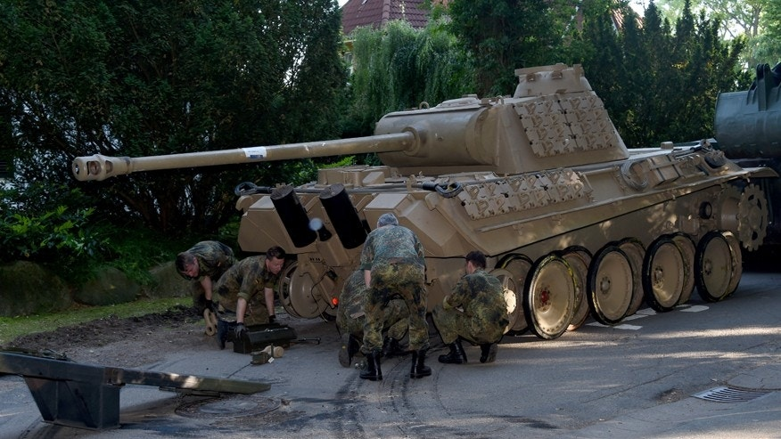 In this July 2, 2015 picture a  World War II -era Panther  tank  is prepared  for transportation from a residential property in Heikendorf,  northern Germany.