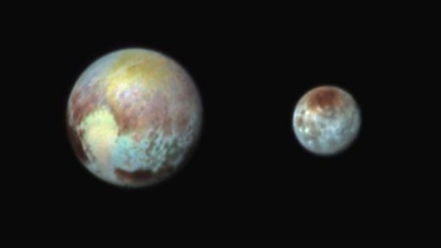 This combination image released by NASA shows Pluto, left, and its largest moon, Charon.