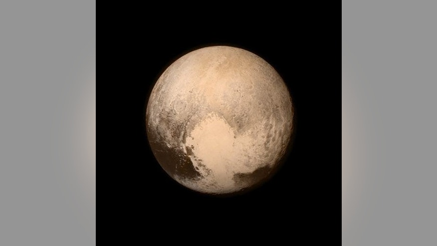 This July 13, 2015 image provided by NASA shows Pluto, seen from the New Horizons spacecraft.