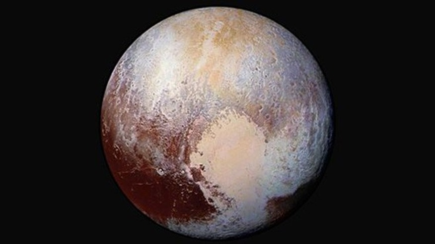 This image made available by NASA on Friday, July 24, 2015 shows a combination of images captured by the New Horizons spacecraft with enhanced colors to show differences in the composition and texture of Pluto's surface. The images were taken when the spacecraft was 280,000 miles away.