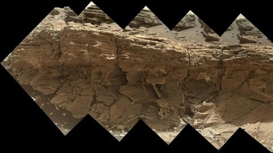 "NASA's Curiosity rover saw this rock outcrop dubbed ""Missoula,"" near Marias Pass on Mars. Image released July 23, 2015."