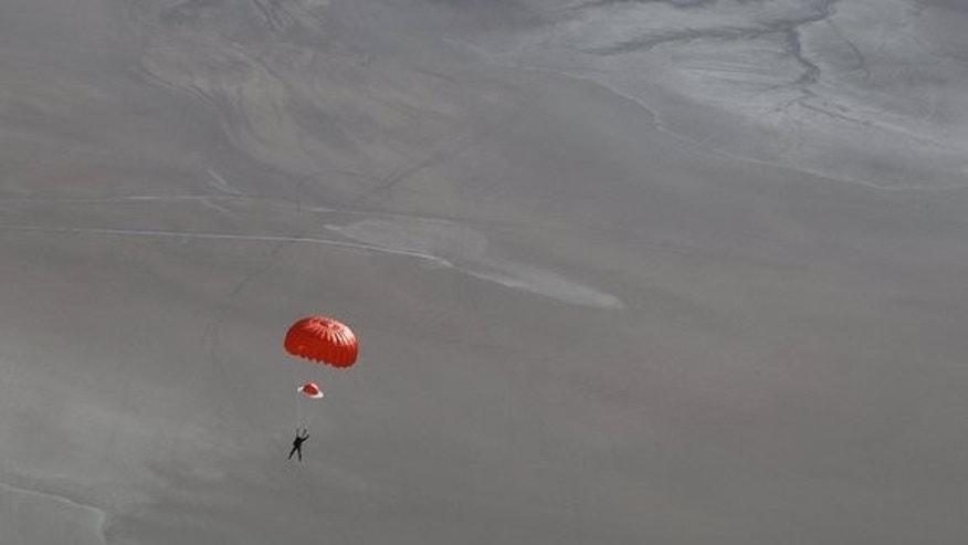 SpaceShipTwo pilot Peter Siebold parachutes to Earth after the space plane broke apart during a test flight on Oct. 31, 2014, killing copilot Michael Alsbury.