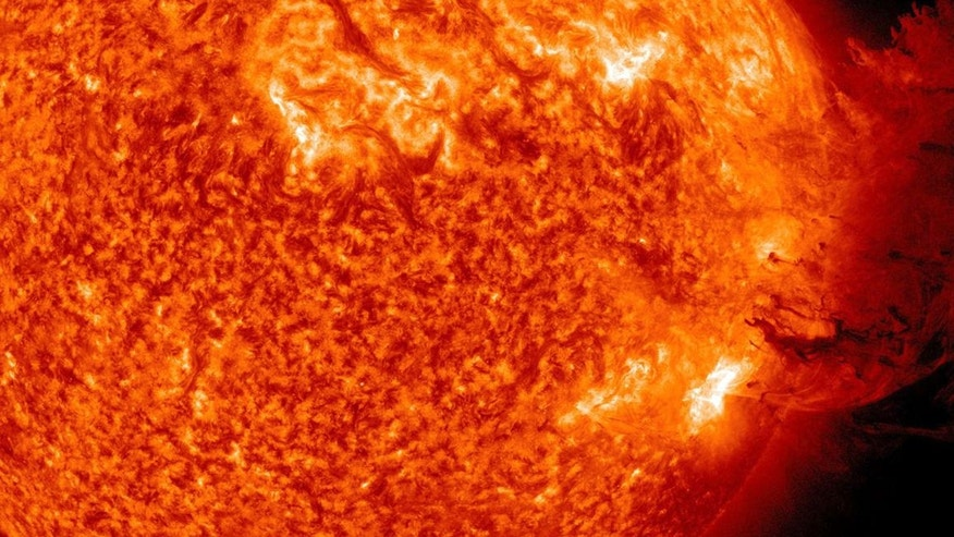 File photo. A handout picture shows Coronal Mass Ejection as viewed by the Solar Dynamics Observatory on June 7, 2011.