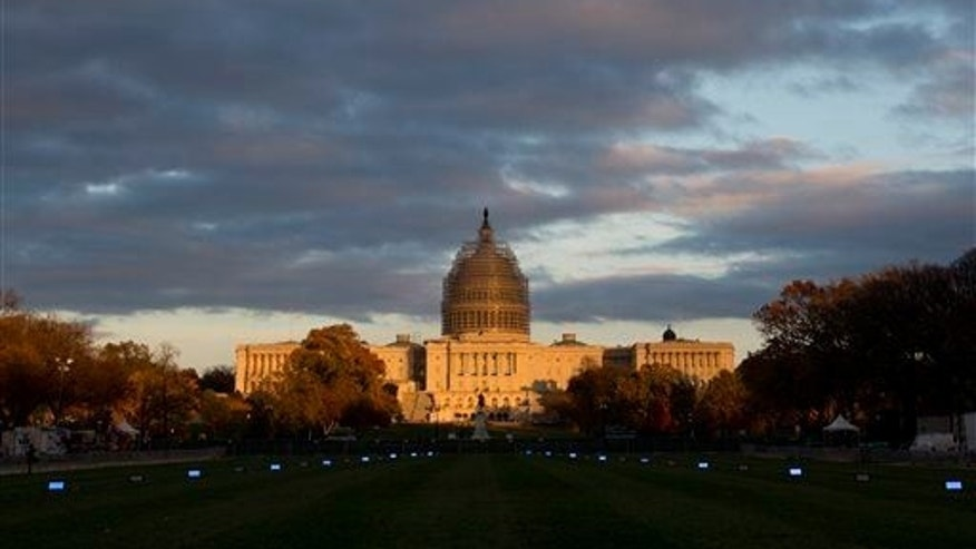 The Capitol Building illuminated by the setting sun on the National Mall in Washington.