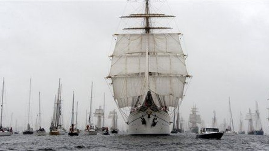 """The  German Navy training ship """"Gorch Fock,"""" center, leads the parade of tall ships during the Kiel regatta week in the Baltic Sea harbor of  Kiel, northern Germany, Saturday June 29, 2013."""