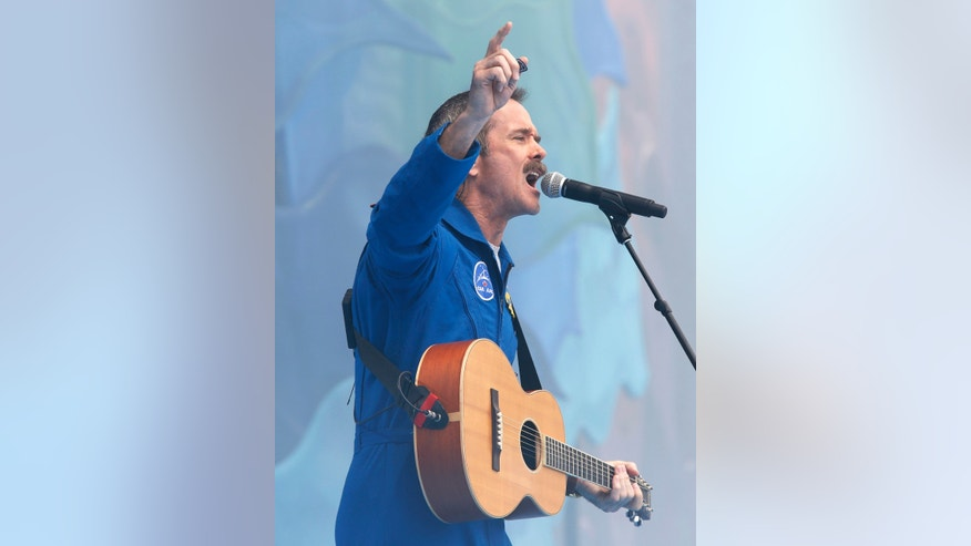 File photo - Chris Hadfield performs during Canada Day celebrations on Parliament Hill in Ottawa July 1, 2013.