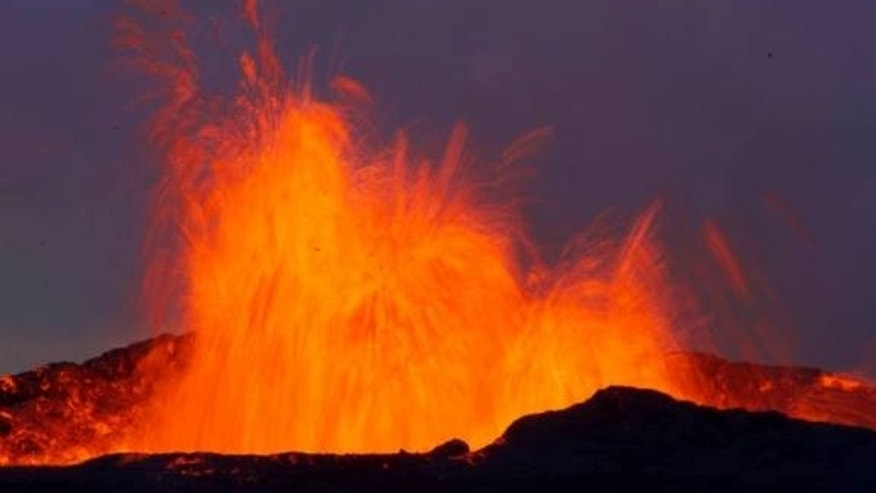 This fire-fountain eruption in Iceland is similar to those that peppered the moon shortly after its formation. The earthly explosion is driven by water and carbon dioxide gas, but new research suggests carbon monoxide was the culprit on the ear