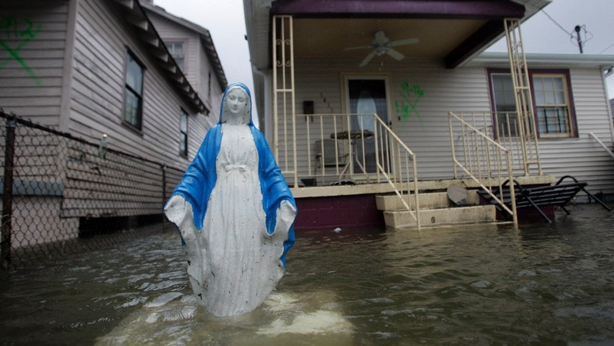 File photo - A statue of the Virgin Mary is seen standing in flood waters in the lower Ninth Ward in New Orleans, Louisiana Sept. 23, 2005.