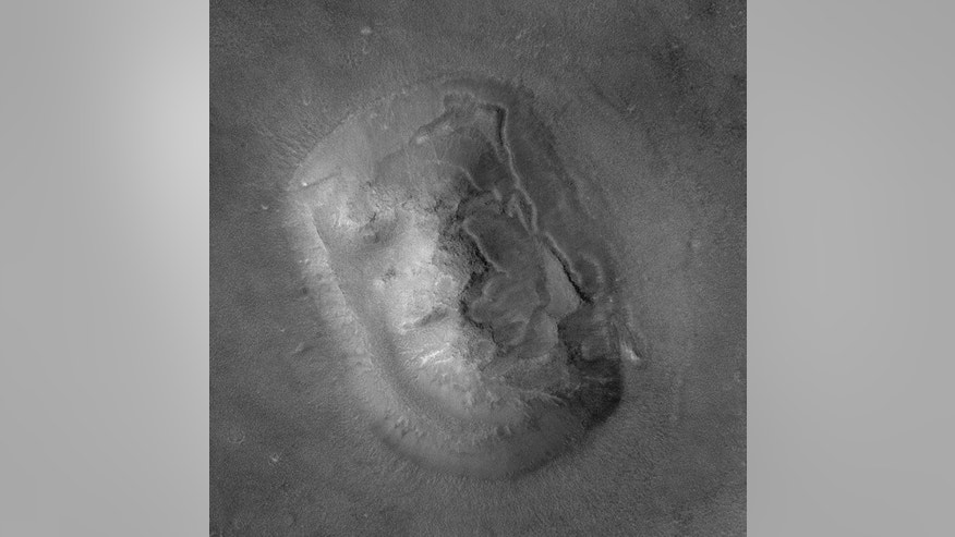"A second look by the Mars Global Surveyor at the so-called Viking ""Face on Mars"" in Cydonia revealed a more ordinary-looking hill, showing that science is an extended process of discovery."