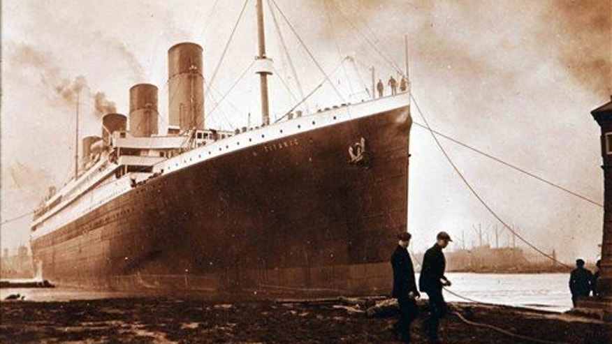 This image made available by the Ulster Folk & Transport Museum on Tuesday, Oct. 14, 2014, is a photograph of the Titanic in Belfast in a family album.