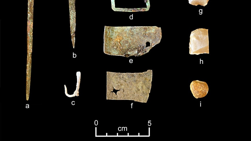 A representative collection of artifacts discovered in July 2015 includes (from left) part of a set of dividers, a nail, a fishhook, a buckle, sheet copper, gun flints and a musket ball.