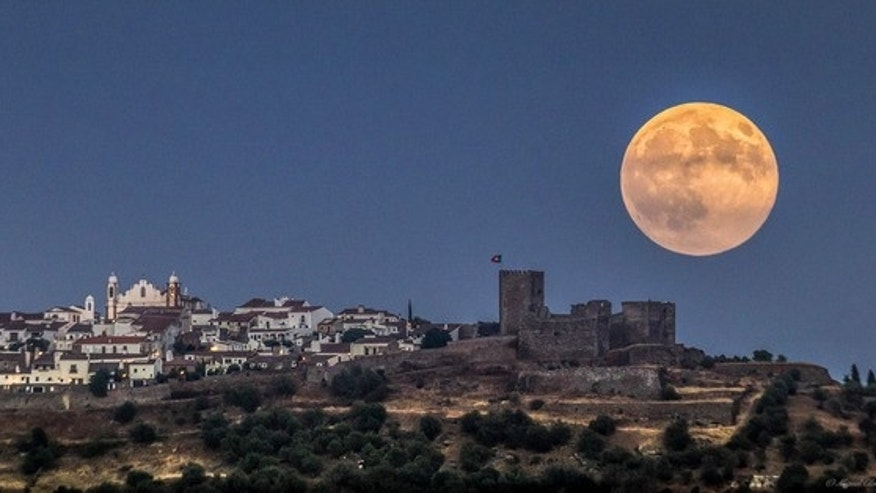 Photographer Miguel Claro snapped this photograph of a full moon over Monsaraz from Portugal's Dark Sky Alqueva Reserve Aug. 29.