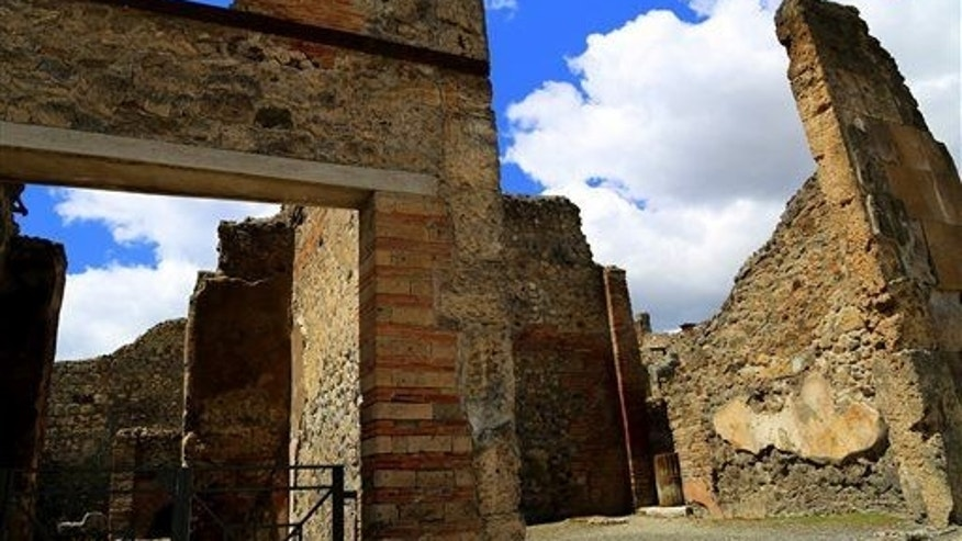In this May 14, 2014 photo, the sun shines on ruined walls in Pompeii, near modern-day Naples, Italy.