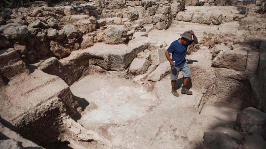 Sept. 21, 2015: A worker for the Israel Antiquities Authority walks at an archaeological site at Ben Shemen Forest near the Israeli city of Modiin. Israeli archaeologists may be one step closer to solving a riddle that has vexed explorers for more than a century: the location of the fabled tomb of the biblical Maccabees. (AP Photo/Dan Balilty)