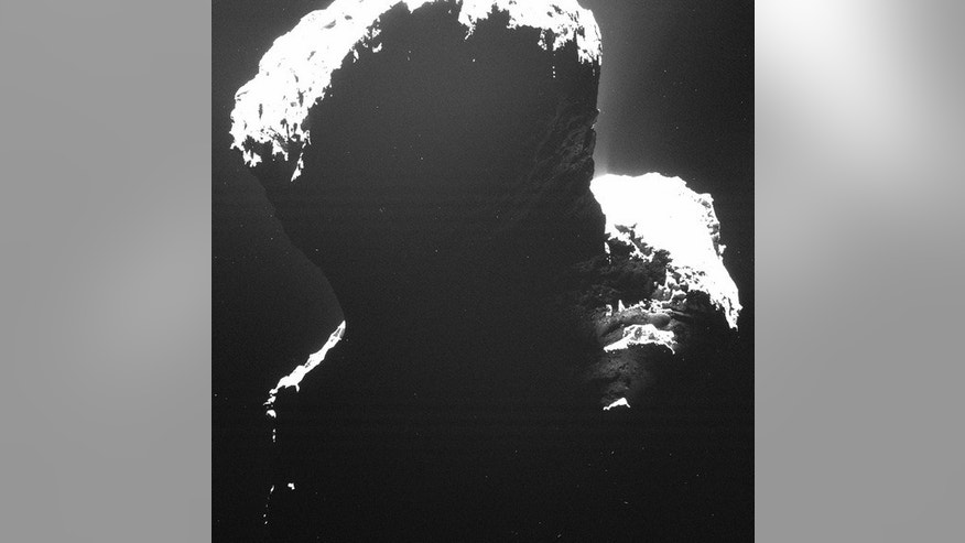 "Comet 67P's ""dark side,"" its southern polar region, as imaged by Rosetta's Optical, Spectroscopic and Infrared Remote Imaging System. This region, in shadow for 5.5 years, has only recently been touched by sunlight."