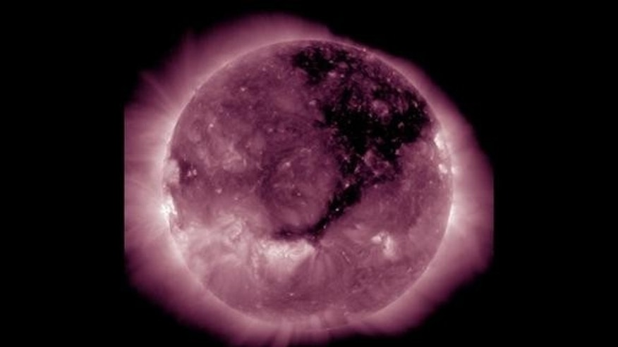 A Solar Dynamics Observatory image published by the National Oceanic Atmospheric Administration reveals the huge coronal hole as it was yesterday. Continuing its march solar west (to the right), the hole is still releasing an extra-fast solar w