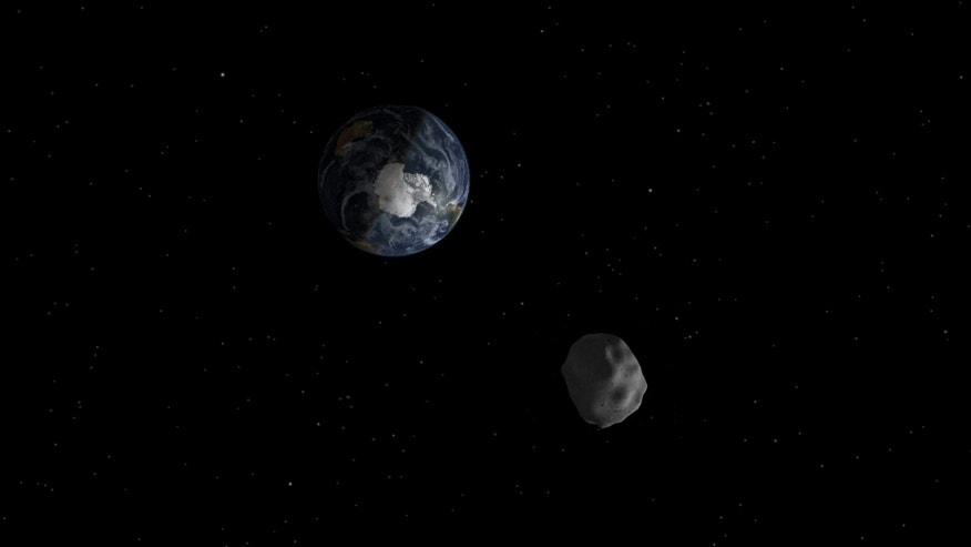 Diagram depicting the passage of asteroid 2012 DA14 through the Earth-moon system on Feb. 15, 2013. (Image credit: NASA/JPL-Caltech)