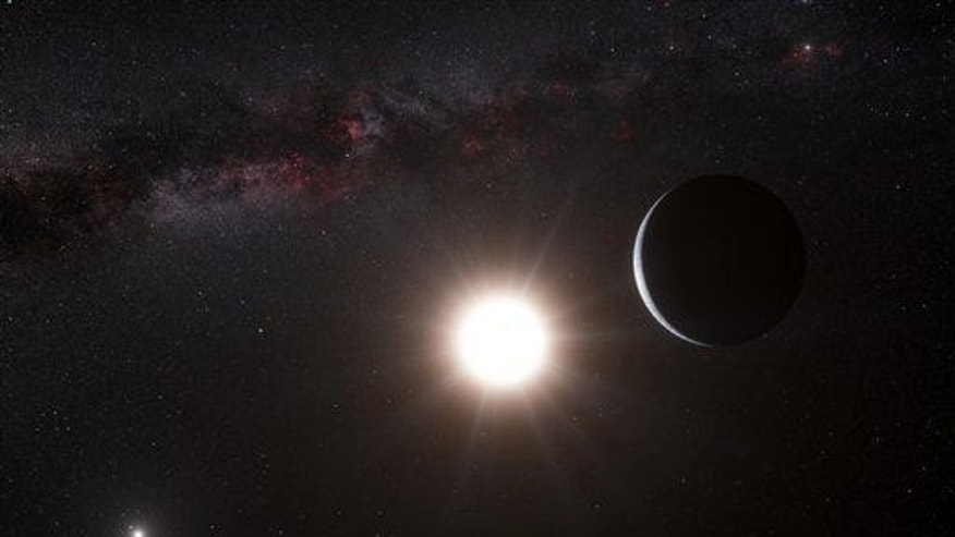 This artist���s impression made available by the European Southern Observatory  shows a planet, right, orbiting the star Alpha Centauri B.