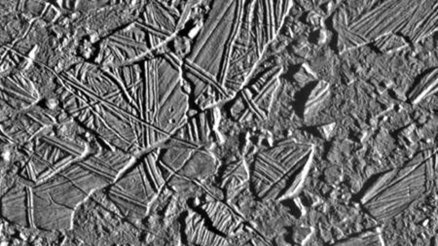 "On Europa, ""chaos terrains"" consist of regions where the icy surface appears to have broken apart, the broken pieces moved around, and then those pieces froze back together."