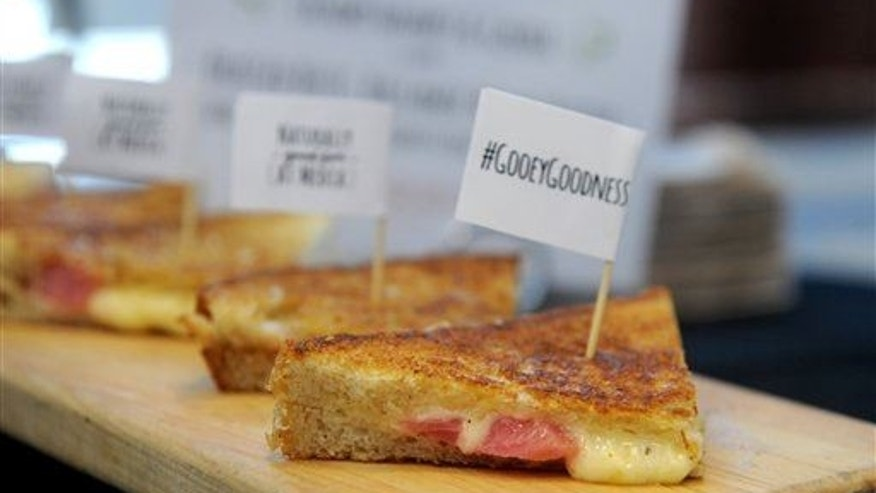 To celebrate National Grilled Cheese Month, cheese company Arla Dofino serves up signature Havarti, Gouda and braised beet grilled cheese sandwiches from Morris Truck, Wednesday, April 1, 2015 in New York.